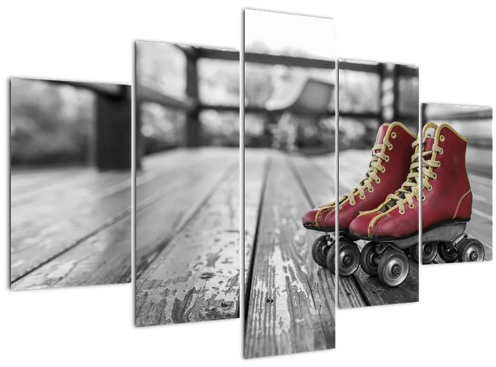 Egy piros régi görgős cipő képe (150x105 cm)